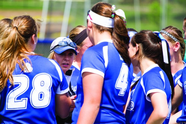 The team gathers for a pep talk on the field on Sunday. JOEL VENZKE | PHOTO EDITOR
