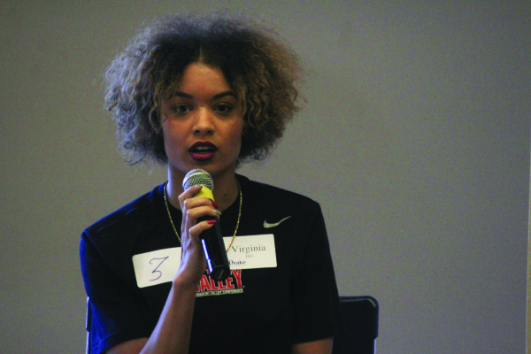 Virgina Hill shares her opinion on race and democracy at the #UniteIowa event. Hill was a part of the team that planned the event in Parent's Hall. PHOTO BY CASSANDRA BAUER | STAFF PHOTOGRAPHER