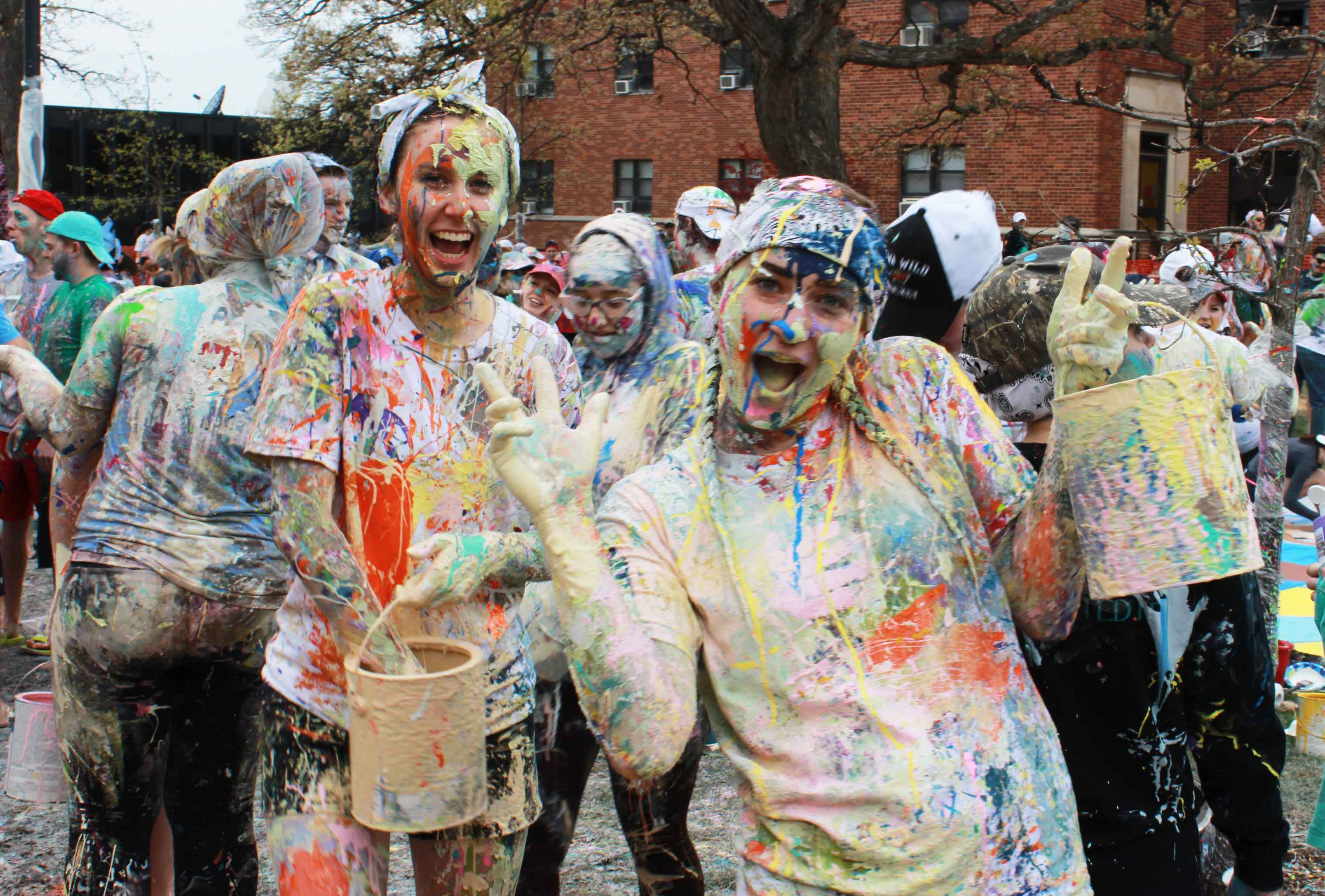 Students With Paint Buckets During the Paint Fight